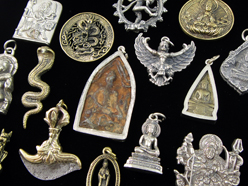 small brass pendants and statuettes