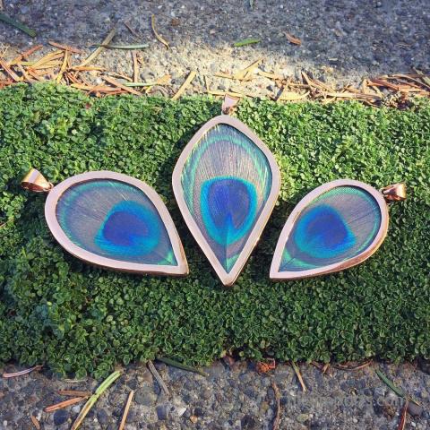 copper peacock pendants shown outdoors