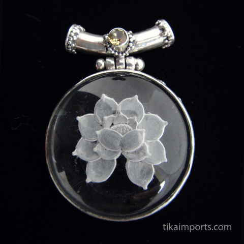 Sterling silver pendant featuring Quartz Crystal carved with the image of a lotus and a Citrine accent stone