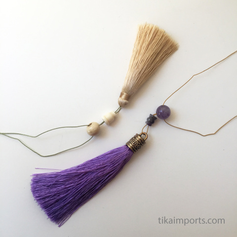 tassels and guru beads shown being strung together
