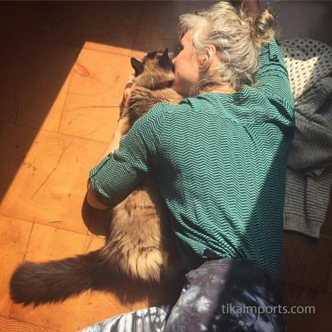Tika girl Corrine cuddling with Bodhi the office kitty