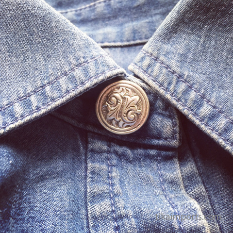 Silver repousse buttons sewn on to a shirt