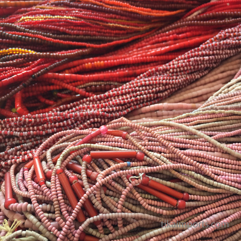 closeup detail of Small African Trade Bead Strands in dusty pink and red