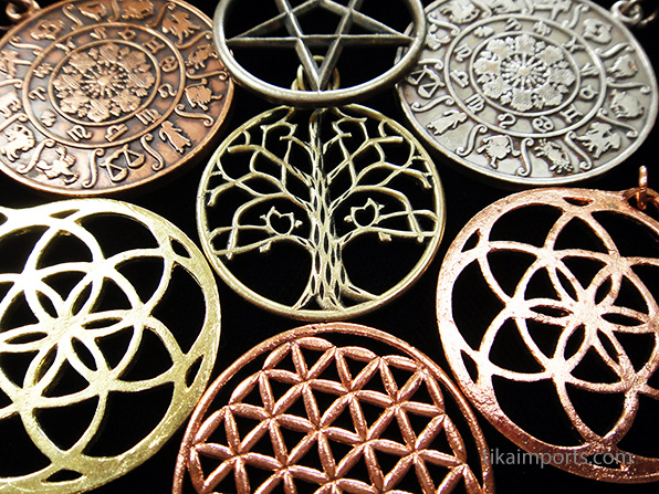 a collection of sacred symbol pendants in copper and brass
