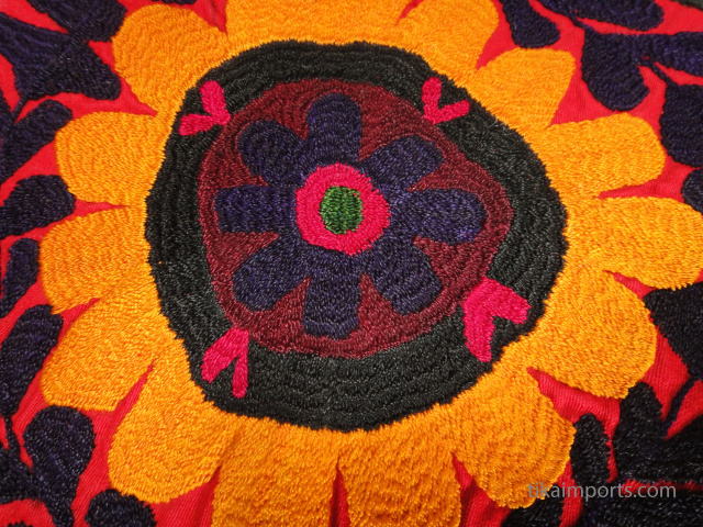 closeup detail of vintage suzanni embroidered textile from Central Asia