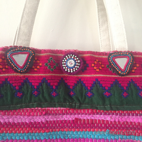 custom bag embellished with Tika items- closeup of dress flowers and Afghani textile