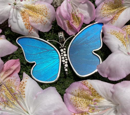 large blue butterfly pendant nestled in Spring flowers