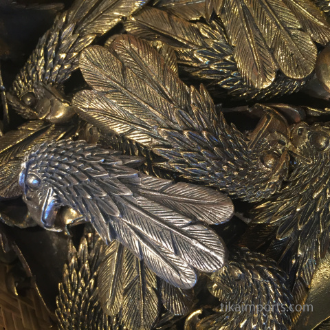 closeup texture detail of brass eagle pendants