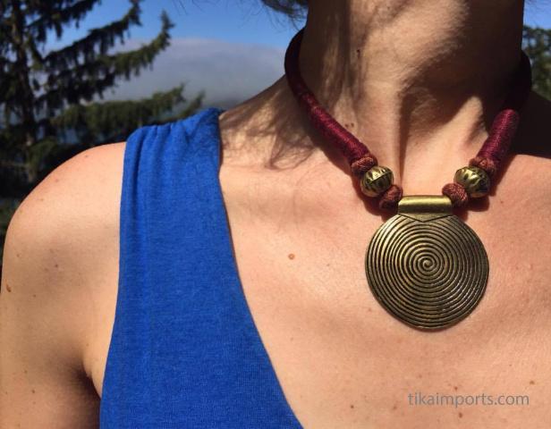 Naga Brass Disc Necklace shown being worn