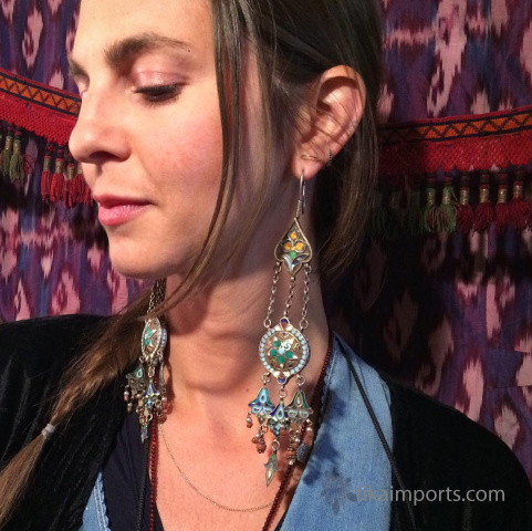 antique enameled earrings being modeled by Tika girl Lindsey