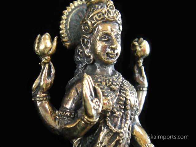 Lakshmi brass deity statuette