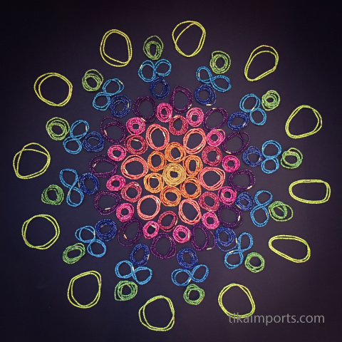 mandala made from 3mm rainbow bone necklaces
