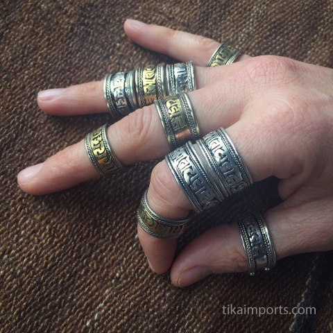 om ring 10pc assortment - shown being worn