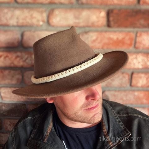snake vertebrae choker worn as a hat band