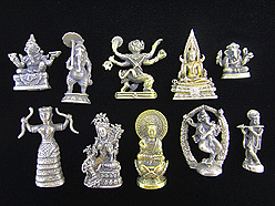 small brass statuettes and pendants