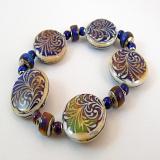 color changing mirage bead stretch bracelet showing color variation