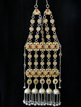 full view of Antique Turkoman Yamut chest piece, shown hanging