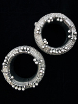 Pair of Old Indian Repousee Silver Hollow-form Bracelets