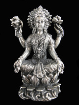 seated Lakshmi brass deity statue, the Goddess of abundance and prosperity