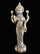 standing Lakshmi brass deity statue, the Goddess of abundance and prosperity