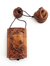 snake inro box with netsuke and ojime slider bead.
