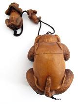 Three monkeys inro box showing back side