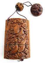 large handcarved boxwood Inro box with carved bats in flight. Bats traditionally represent longevity and happiness.