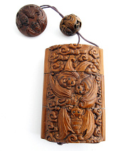 large handcarved boxwood Inro box with carved bats in flight, showing reverse side