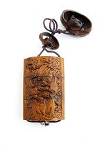 Small handcarved boxwood Inro box with carved bats in flight. Bats traditionally represent longevity and happiness.
