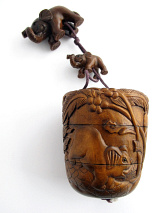 handcarved barrel-shaped boxwood Inro box with carved elephants