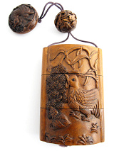 handcarved boxwood Inro box with a rooster on one side and feeding chics on the reverse.