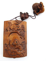handcarved boxwood Inro box with squirrels, showing reverse side