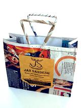 showing an open Jan Sandesh Newspaper Gift Bag