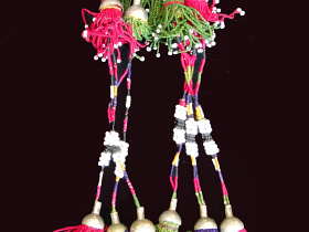 Double Tassle Set from Afghanistan with colorful twisted thread, silver caps and beaded embellishments