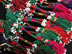 closeup of Vintage Turkoman Double Tassel set from Central Asia