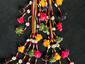 Vintage Turkoman tassel set with woven flat straps and intricately tied knots