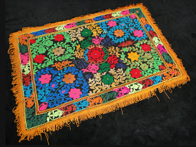 small vintage textile from Central Asia featuring floral design and fringe