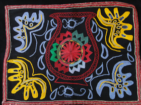 black textile with embroidered detailing