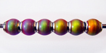 Hot pink color-changing Mirage beads with brass core