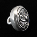 side view of sterling silver repouse shank-button with trefoil design