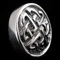 side view of sterling silver repouse shank-button with celtic knot design