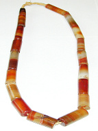 view of full strand of rounded tube-shaped antique Carnelian