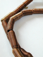 closeup of traditional coiled copper beads