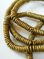 closeup of Contemporary Traditional African Brass Heishi beads.