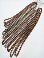 African heishi spacer bead strands, showing a typical 10pc assortment