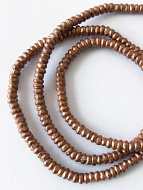 closeup of Contemporary Traditional African Copper Heishi beads