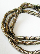 closeup of silver-toned brass spacer beads