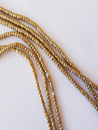 Contemporary Traditional tiny African Golden Brass-Thread beads.