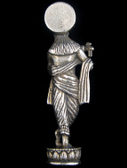 back of Krishna brass deity statue, god of love and compassion playing his flute