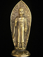 standing Buddha brass deity statue, the sage on whose teachings Buddhism was founded